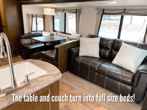 Interior couch and table turn into full sized bed for additional guests
